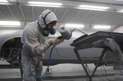 Beau spraying primer on decklid